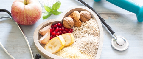 Heart shaped bowl of grains, fruits and other healthy resources