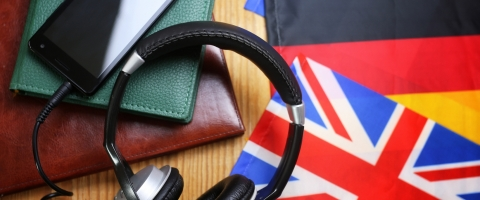 Headphones, books, and various national flags representing Language Learning resources.